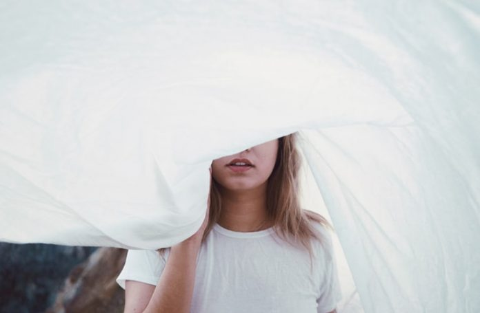 woman under white cloth