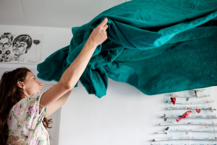 woman holding a green fabric